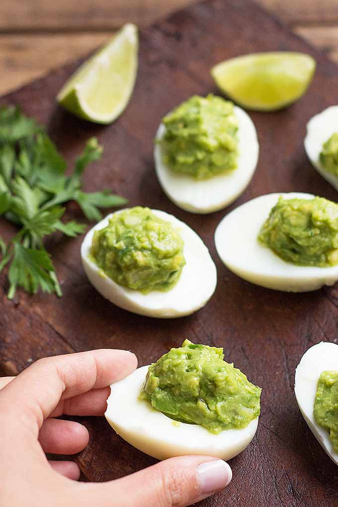 These guacamole deviled eggs are flavorful, high in protein, and rich in healthy fats. Get this tasty recipe now on Foodal: https://foodal.com/recipes/appetizers/guacamole-deviled-eggs/
