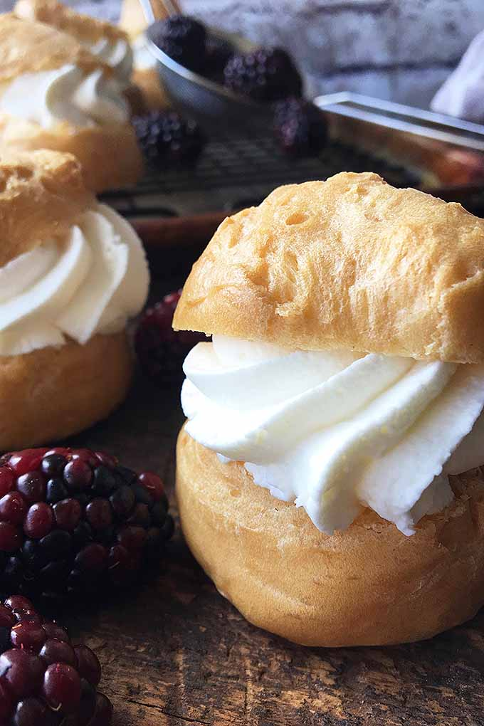 Stuffed with a fluffy whipped topping and served with berries, cream puffs incorporate pretty much everything a fantastic dessert needs. We share our recipe now: https://foodal.com/recipes/desserts/the-perfect-party-treat-heavenly-cream-puffs