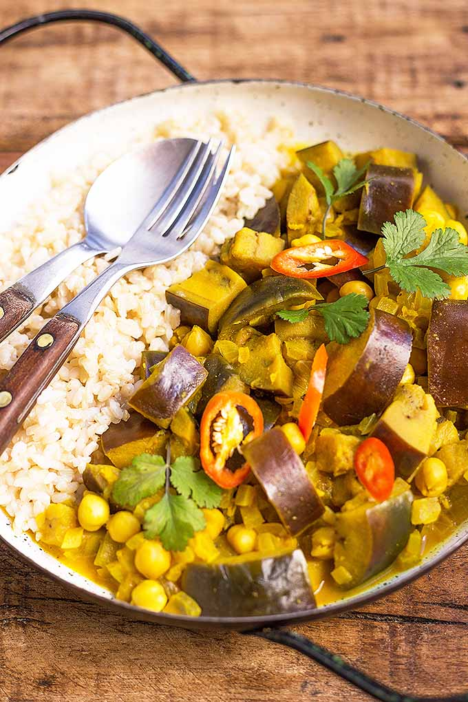 In our spicy curry, tender chunks of eggplant are simmered slowly in a creamy coconut sauce infused with assorted spices. Make this mouthwatering vegetarian dish now: https://foodal.com/recipes/vegetarian-vegan/eggplant-curry/