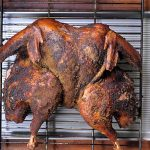 A finished smoked turkey that has been dry brined and dry rubbed with sage and other spices   Foodal
