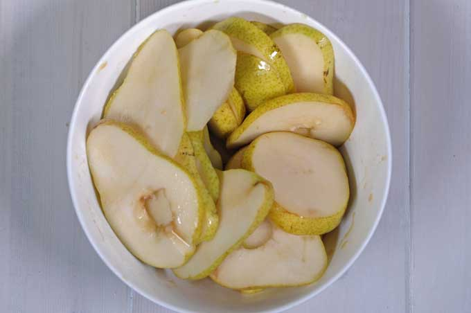 Top down view of bartlett pears sliced into thin pieces | Foodal