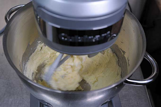 Top down view of the butter and sugar being whipped together by the Cuisinart SM-55 Stand Mixer | Foodal