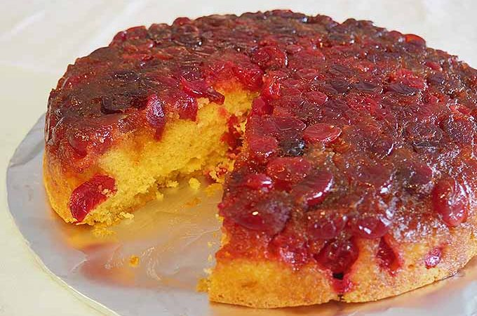 Golden interior of a cranberry-topped holiday cake. | Foodal.com