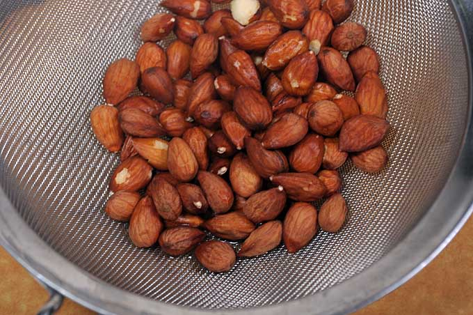 Use a strainer to dry the nuts | Foodal