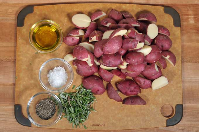 The ingredients for roasted rosemary red potatoes gathered into one place for easy access | Foodal