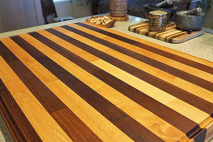 A wooden cutting board that has been cleaned and sanitized | Foodal