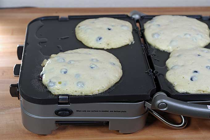 The pancakes are being cooked on top of a Cuisinart GR-4N 5-in-1 Griddler | Foodal