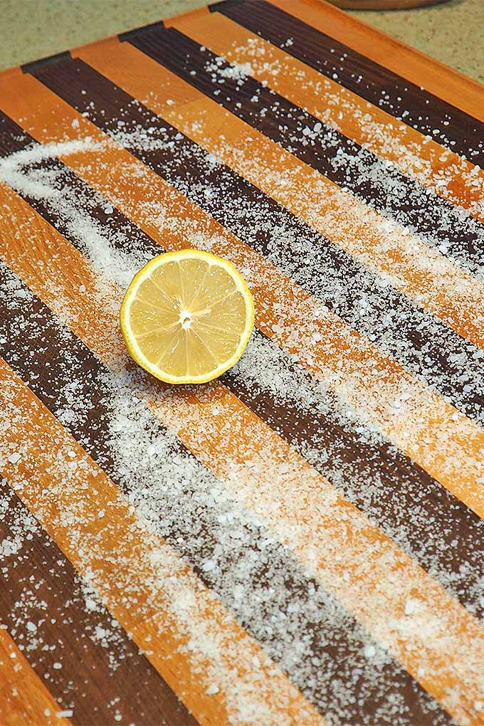 Salt and half a lemon used to cleaning a wooden cutting board | Foodal