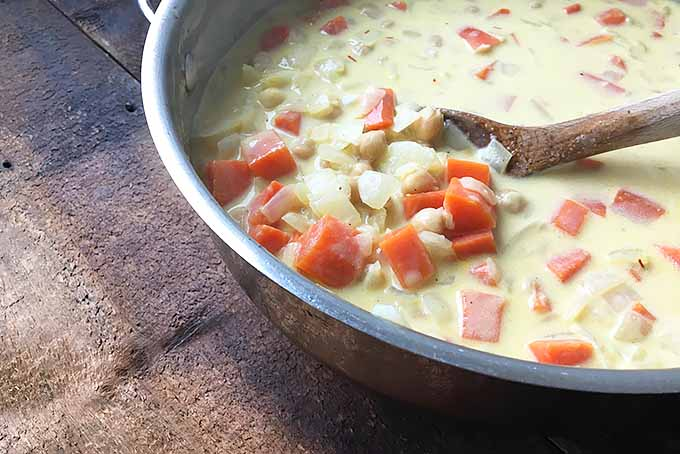 Stirring a silky and creamy vegetarian soup | Foodal.com