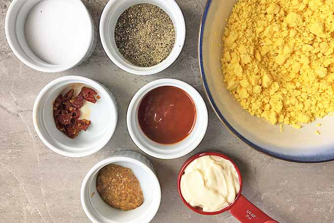 Horizontal image of ingredients for chipotle deviled eggs