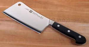 Zwilling Pro 6-Inch Light-weight Meat Cleaver on a maple wooden cutting block.