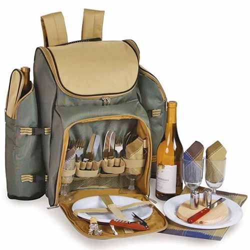 Sage green and tan Tandoor Deluxe picnic backpack with cutlery and flatware, glasses, and a bottle of wine, isolated on a white background.
