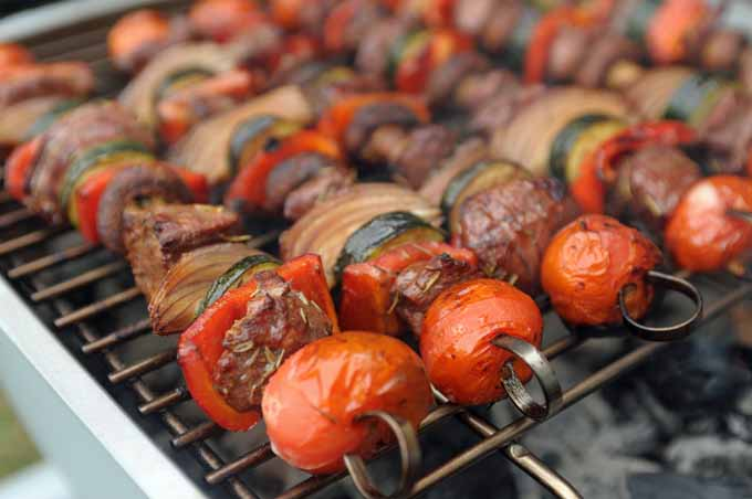 Close up of lamb and veggie kabobs on a PK360 grill.