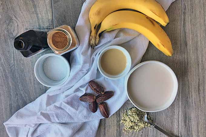 Horizontal image of ingredients for a tahini banana smoothie.