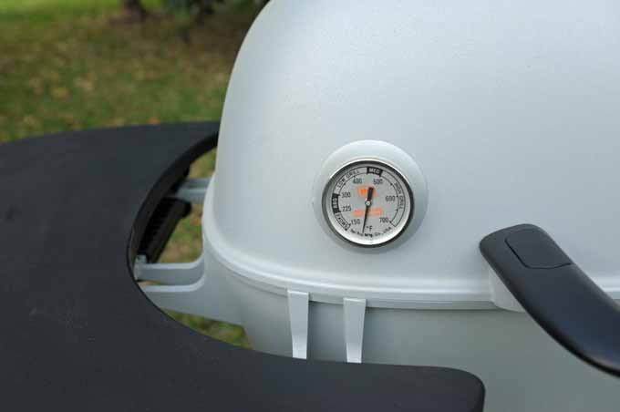 A Tel-Tru thermometer on the lid of the PK360.