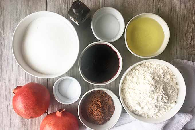 Horizontal image of ingredients for dessert in white bowls.