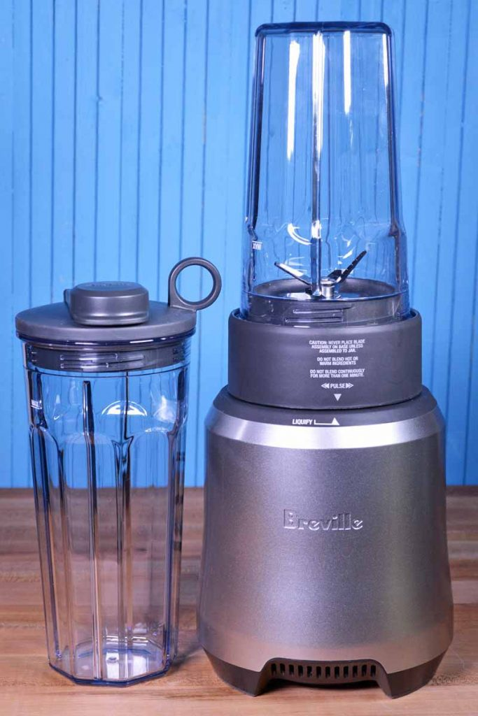 A silver Breville Boss to Go Personal Blender on a blue background.
