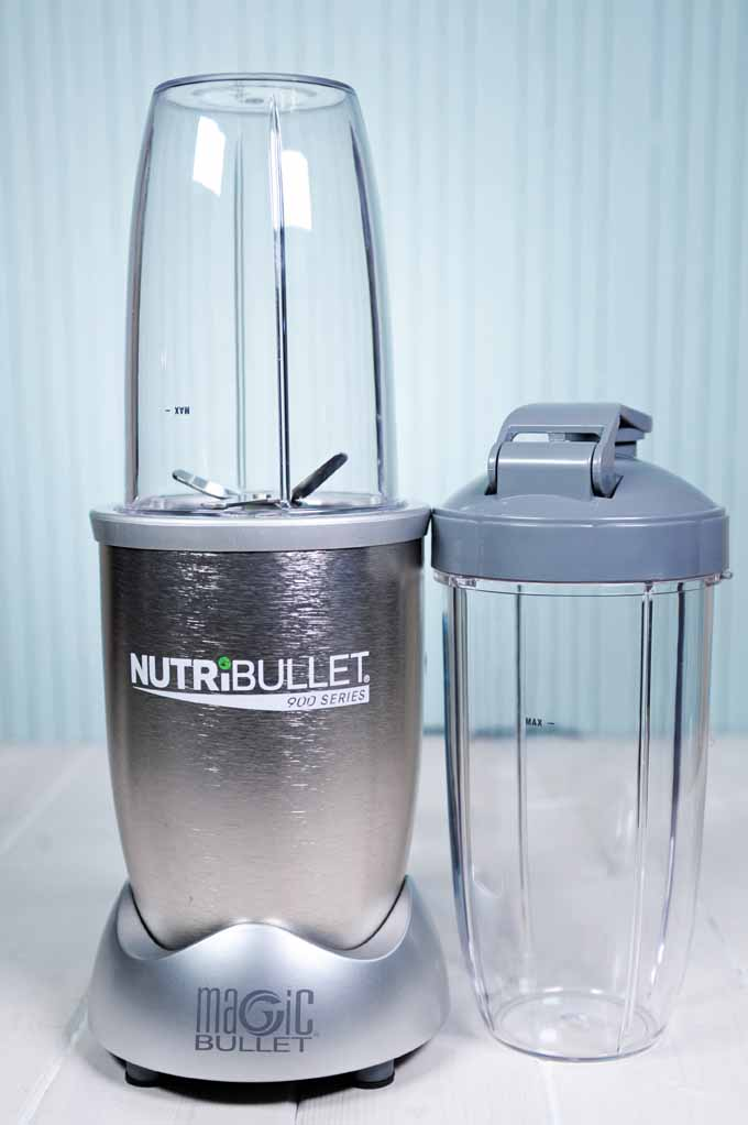 The Nutribullet Pro 900 Personal Blender on a light blue background.
