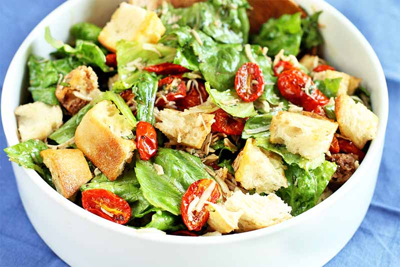 A white serving bowl of homemade panzanella.