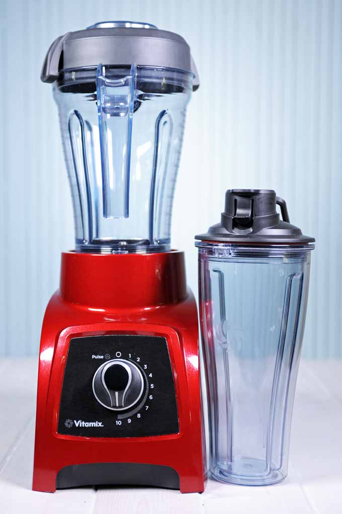A red Vitamix S30 personal blender with a 20 ounce to-go cup and 40 oz pitcher.