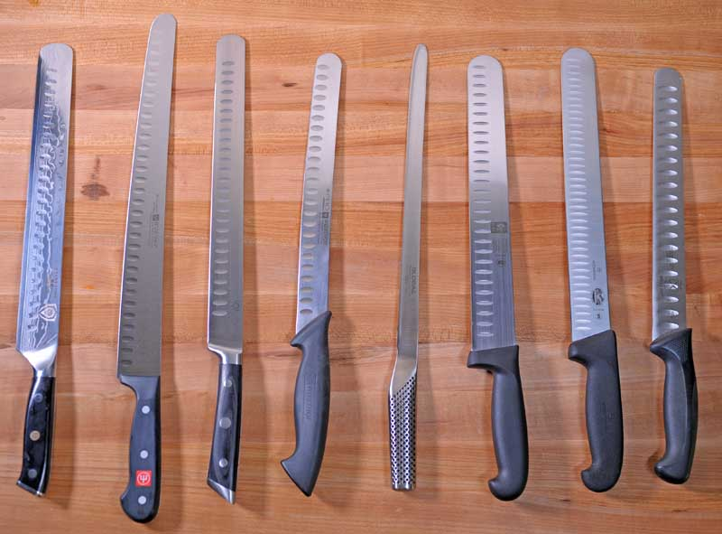 Top down view of 8 different slicing knives from various manufacturers.