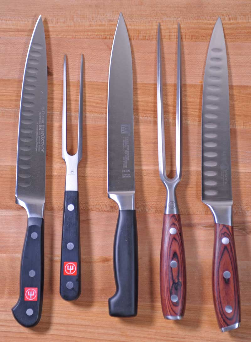 Top down view of three sets of carving knives.