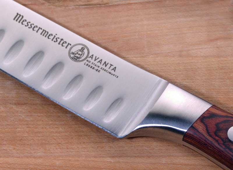 Close of of the label on the blade of the Messermeister Avanta Pakkawood Kullenschliff Carving Knife.
