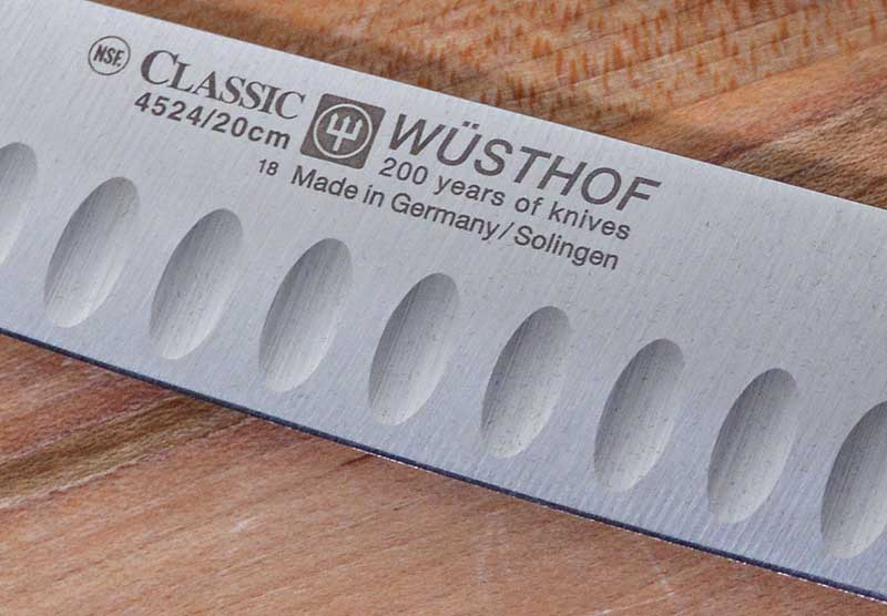 Close up of the laser etched label on the blade of the Wusthof Classic 2-Piece Hollow-Ground Carving Set.