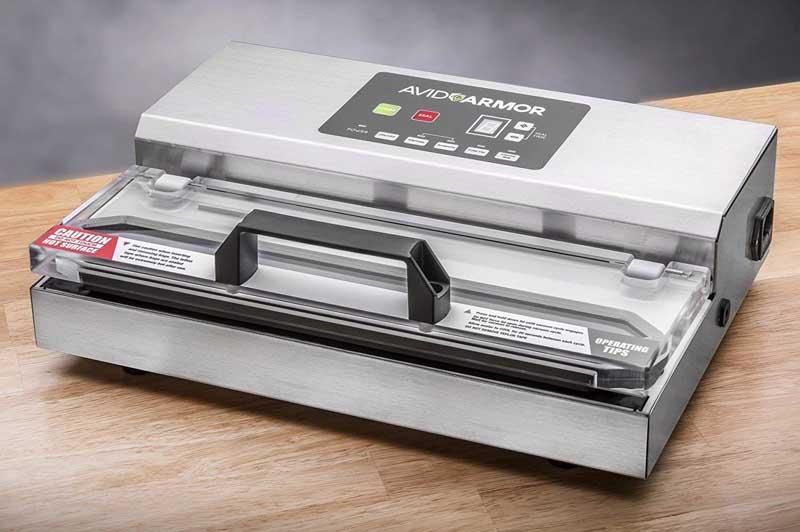 Avid Armor 100 Vacuum Sealer System on a light wooden table top.