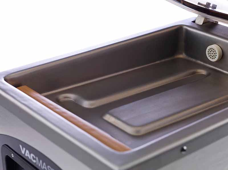 A close up of the chamber interior of the VacMaster VP210 Vacuum Sealer.