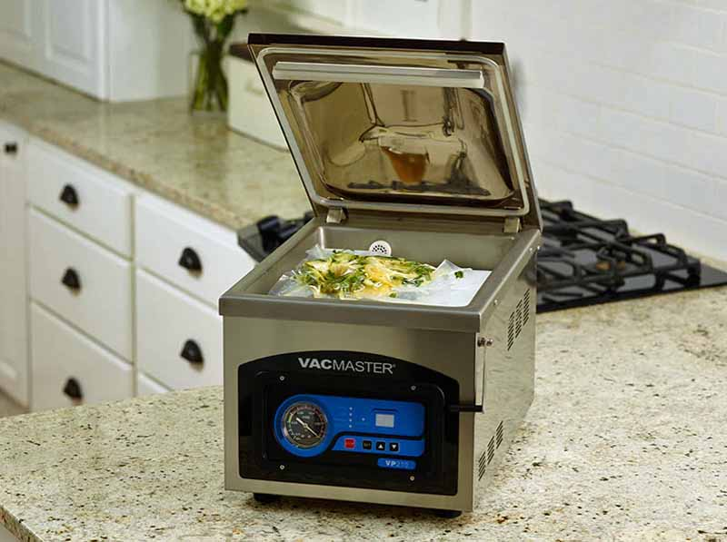 VacMaster VP210 Chamber Vacuum Sealer on a granite kitchen countertop.