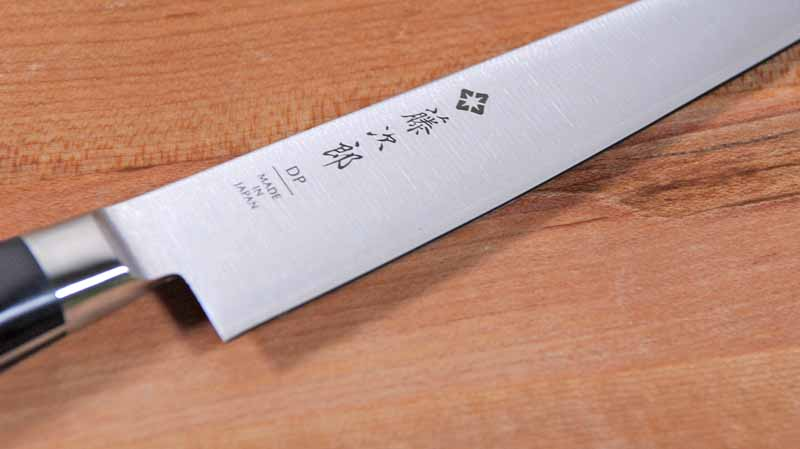 Close up of the laser Tojiro logo etched onto the blade.