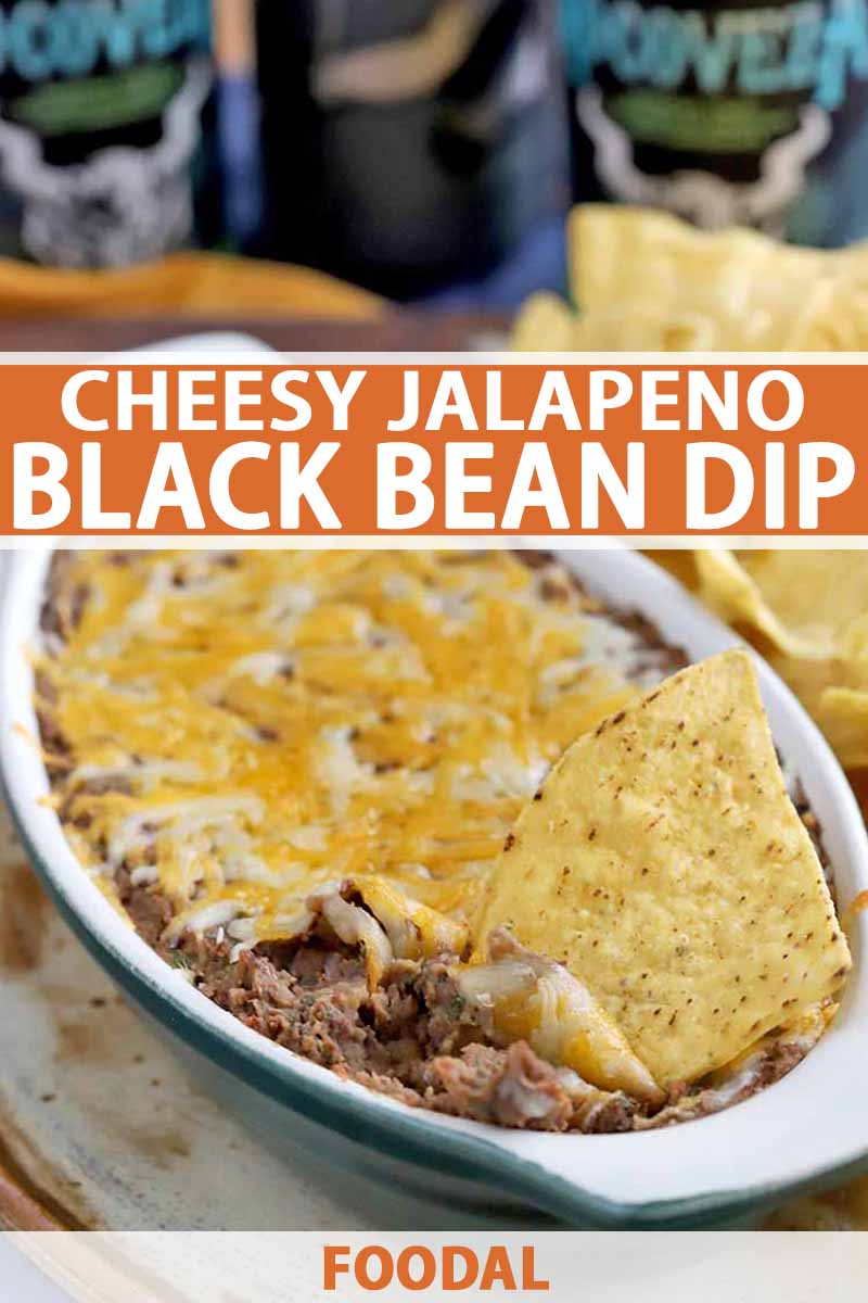 Vertical image taken at an oblique angle of an oblong ceramic baking dish filled with homemade bean dip with melted cheese on top, with yellow corn chips and cans of beer in soft focus in the background, printed with orange and white text.