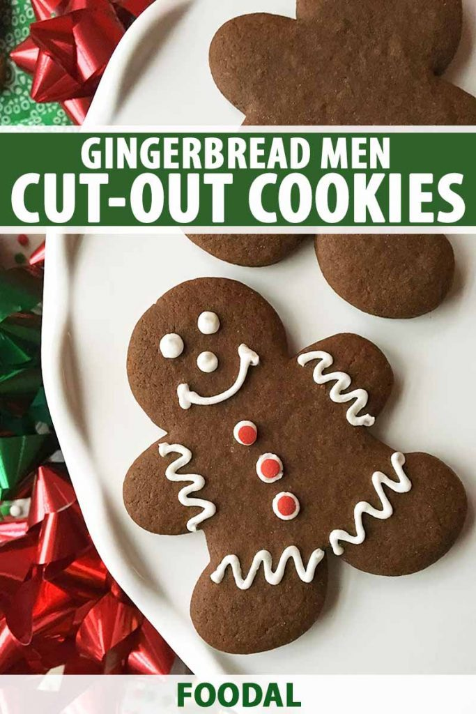 Vertical image of two gingerbread men cut-outs, one decorated, on a white plate next to ribbons with white text on a green background.