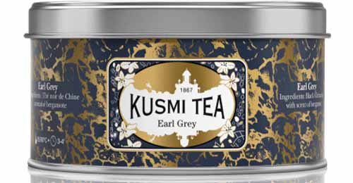 Kusmi Tea Earl Grey tin with gold and blue label, isolated on a white background.