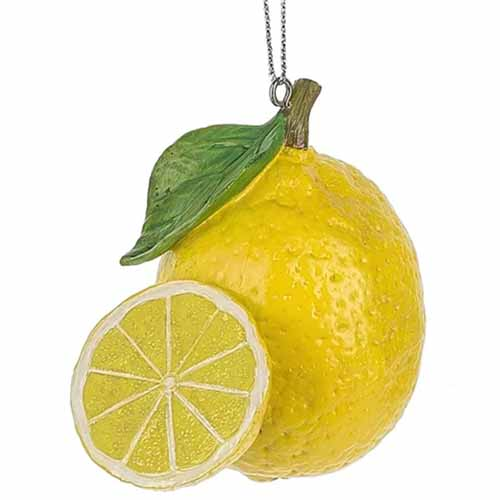 A lemon Christmas ornament, isolated on a white background.