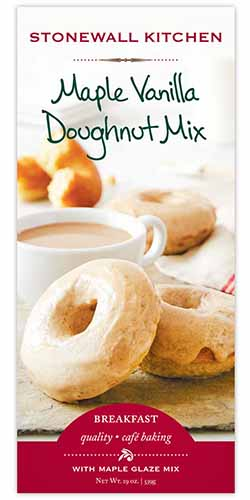 Vertical image of the front of a box of Stonewall Kitchen Maple Vanilla Doughnut Mix.