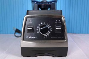 A close up of the base of the Vitamix 750 Professional Series Blender on a blue background.