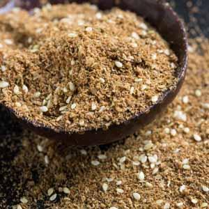 A wooden spoon full of Za'atar Seasoning.