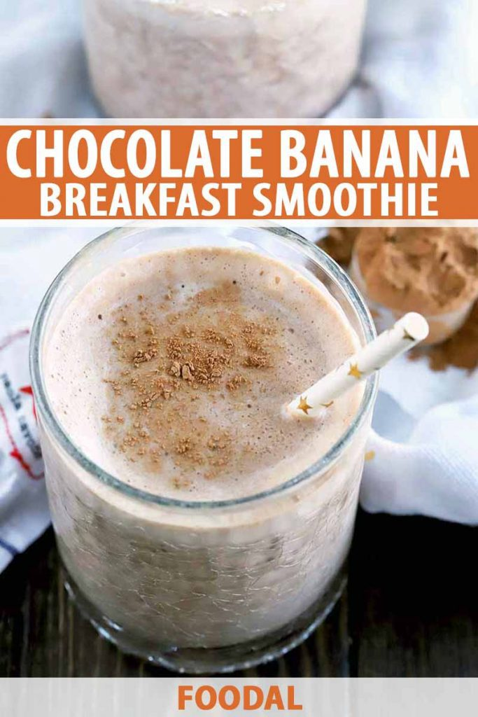 Vertical image of a chocolate and banana smoothie in a glass with a white paper straw, with another identical glass in the background, and a measuring scoop of cocoa powder on a white cloth, on a dark brown wood surface, printed with orange and white text.