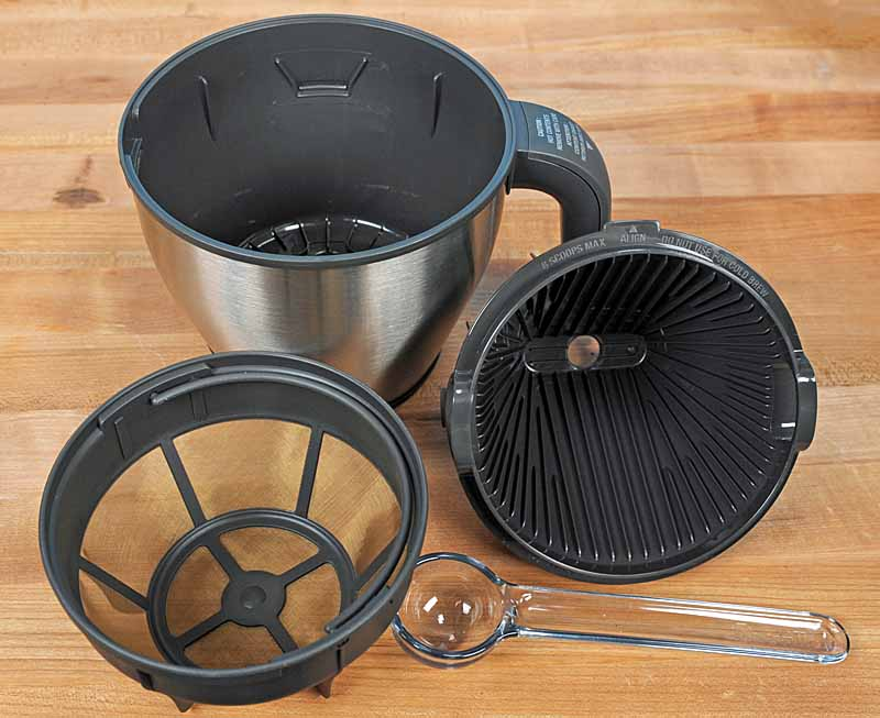 A close up of the metal mesh filter, the filter basket, and cone filter holder for three ways of brewing.