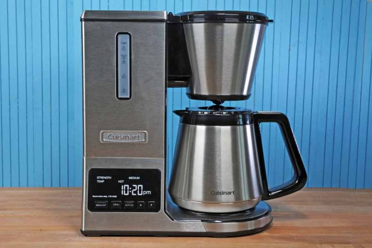 The Cuisinart CPO-850 Pour Over Coffee Brewer with Stainless Steel Thermal Carafe sitting on maple butcher block surface with a blue background.