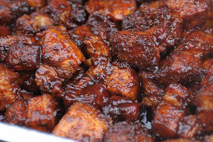Smoked pork belly burnt ends being cooking on the Primo Oval XL 400 Ceramic Kamado Grill.