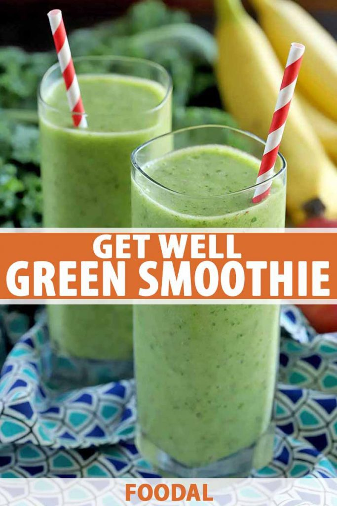 Vertical shot of two tall glasses of green smoothie, with red and white striped paper straws, on a dark and light blue patterned cloth with bunches of kale and bananas in the background, printed with orange and white text.