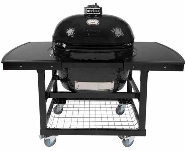 Primo Oval XL Ceramic Kamado Grill On Steel Cart With 2-Piece Island Side Shelves on a white, isolated background.