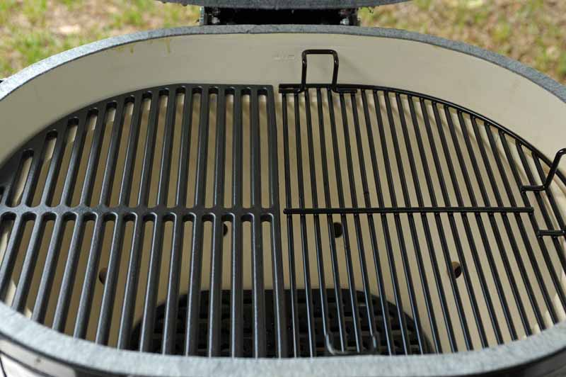 A closeup shot of the cooking surface of the Primo XL400 Kamado, showing both the optional cast iron grate and the stock porcelain grate.