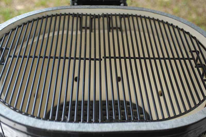 A closeup shot of the porcelain-coated wire racks that come included with the Primo Oval XL 400 Kamado.