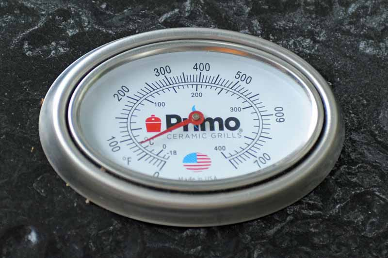 Closeup shot of the in-lid thermometer on the Primo Oval XL 400 Ceramic Kamado.