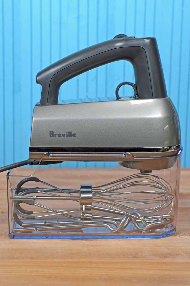 The Breville Hand Mixer with all attachments and the body inserted into its plastic case.