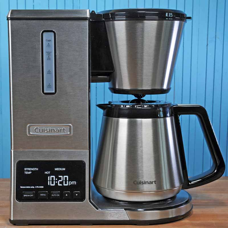 The Cuisinart CPO-850 Pour Over Coffee Brewer with Stainless Steel Thermal Carafe, sitting on maple butcher block surface with a blue background.